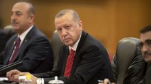 Turkish lira sinks against the US dollar as Erdogan sacks central bank chief
