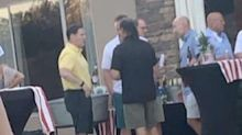 Photo shows Arizona's governor without a mask at party with no social distancing days before telling constituents to 'arm yourself with a mask'