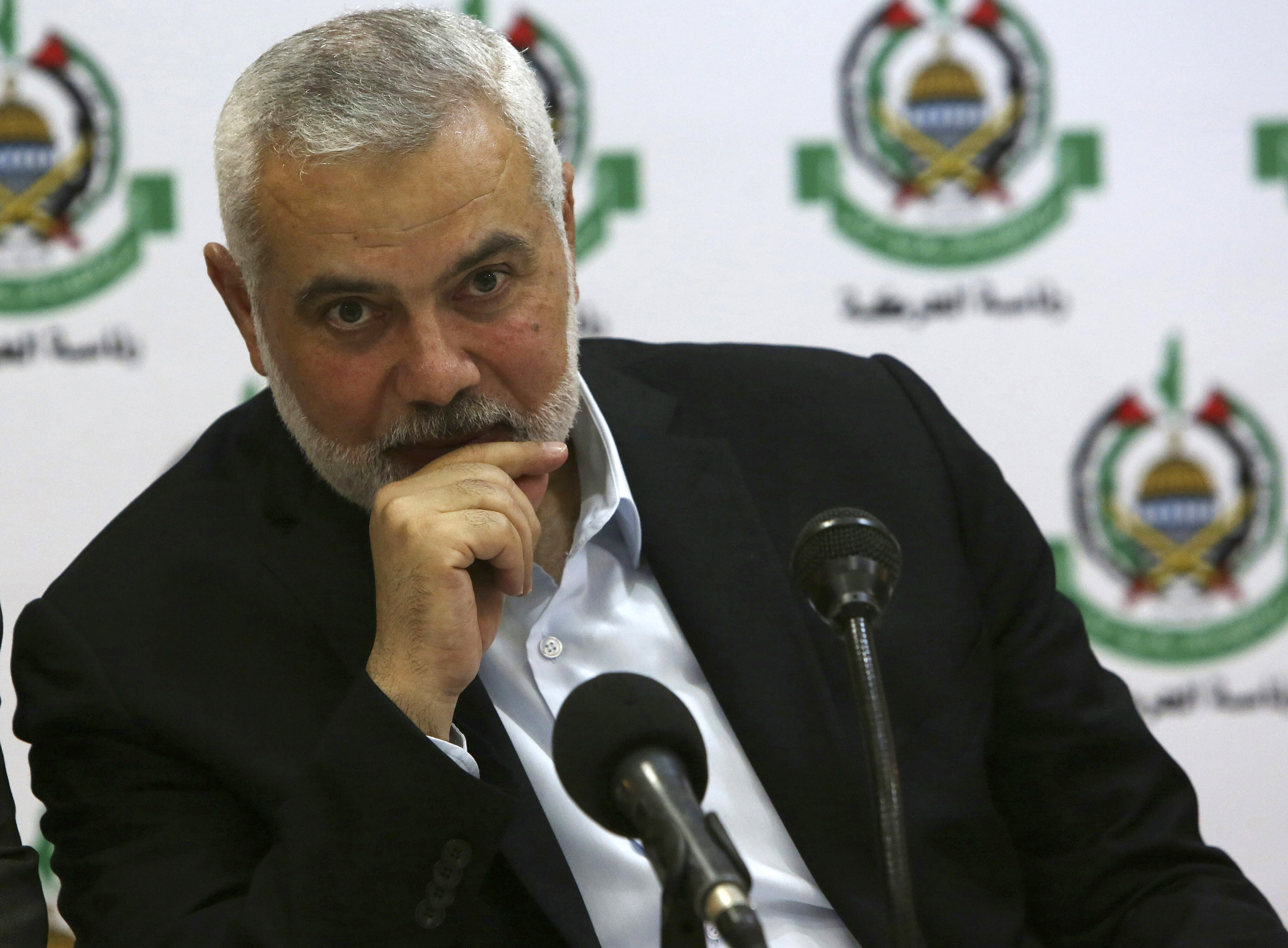 Hamas' chief Ismail Haniyeh attends a meeting with foreign reporters at al-Mat'haf hotel in Gaza City, Thursday, June 20, 2019. Hamas' chief says Israel is ignoring the terms of an indirect cease-fire agreement for the Gaza Strip. (AP Photo/Adel Hana)