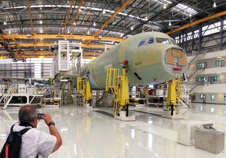 FILE PHOTO: The first U.S.-made Airbus jetliner moves down the assembly line at the company's Alabama factory in 2015