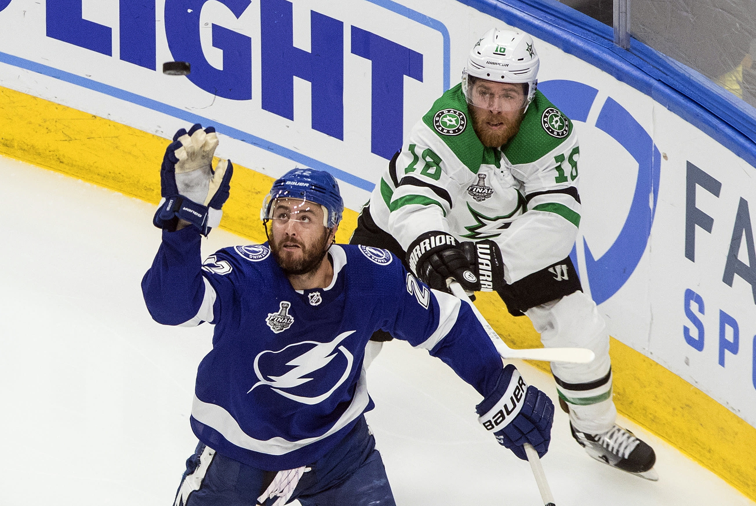 Dallas Stars' Joe Pavelski (16) and Tampa Bay Lightning's Kevin Shattenkirk (22) battle for the puck during third-period NHL Stanley Cup finals hockey action in Edmonton, Alberta, Monday, Sept. 21, 2020. (Jason Franson/The Canadian Press via AP)