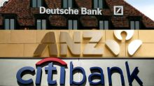 Australia issues cartel charges to three banks