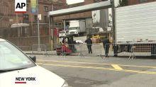 Dead moved onto trucks outside NY hospital