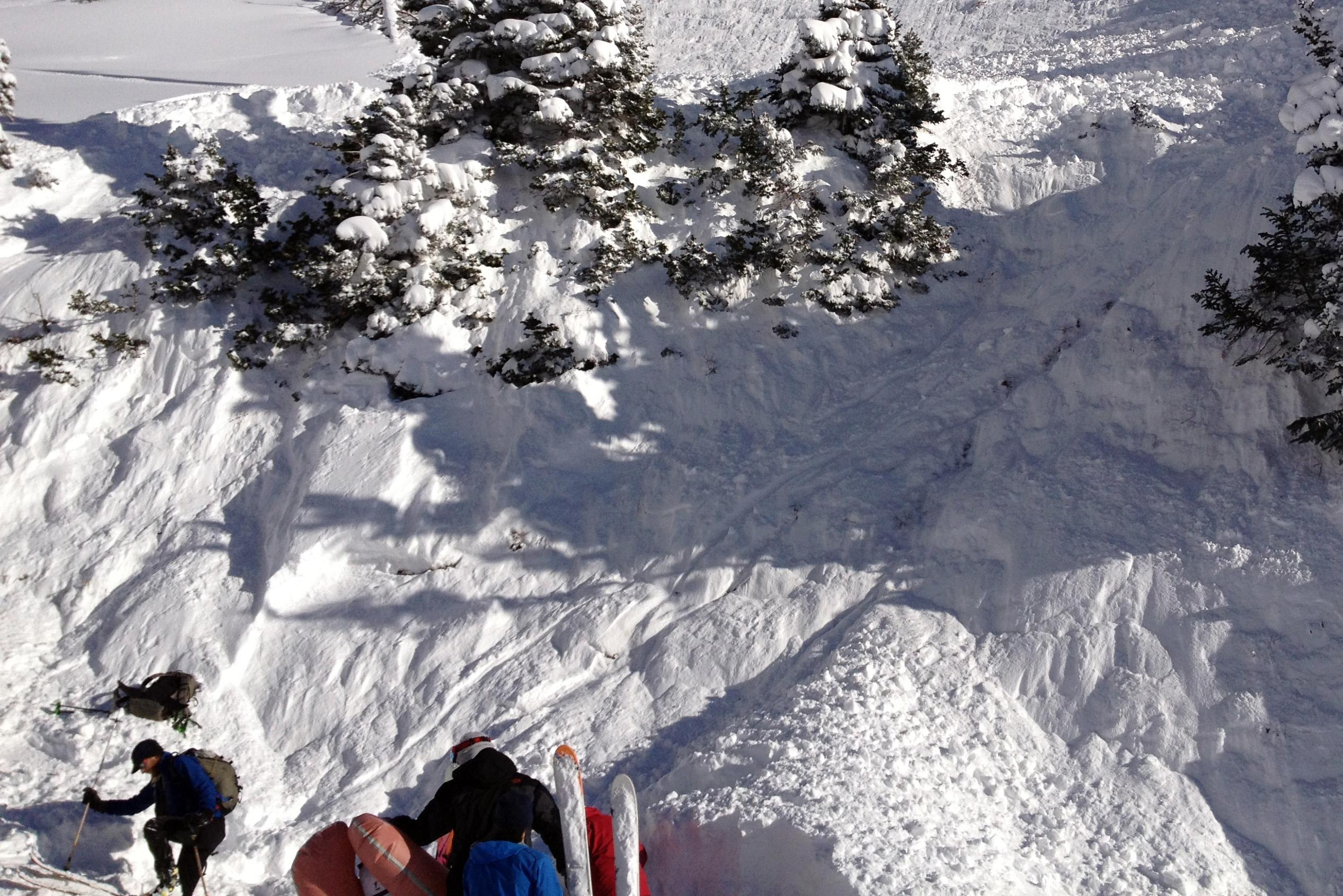 In this photo provided by Joseph Campanelli, the third in a sequence of three images, rescuers dig out a woman buried in an avalanche she triggered in a steep ravine called Grizzly Gulch, just outside the Alta ski area east of Salt Lake City, Monday, Dec. 9, 2013. The woman survived because she deployed a special air bag and other skiers were able to quickly dig her out. It was the first time this season that a person has been caught in an avalanche in the Utah. Authorities say say she could've been trapped longer under much deeper snow without the air bag. (AP Photo/Joseph Campanelli)