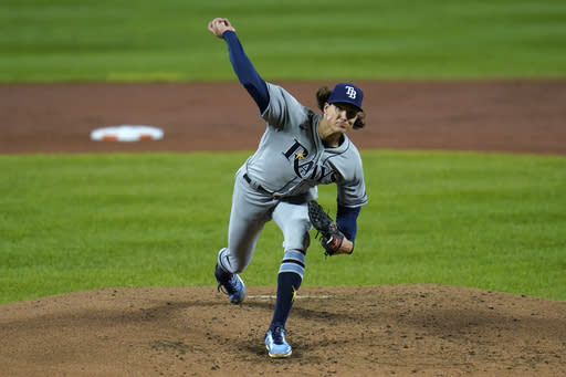 Tampa Bay Rays pitcher Tyler Glasnow throws a pitch to the Baltimore Orioles during the second inning of a baseball game, Friday, Sept. 18, 2020, in Baltimore. (AP Photo/Julio Cortez)
