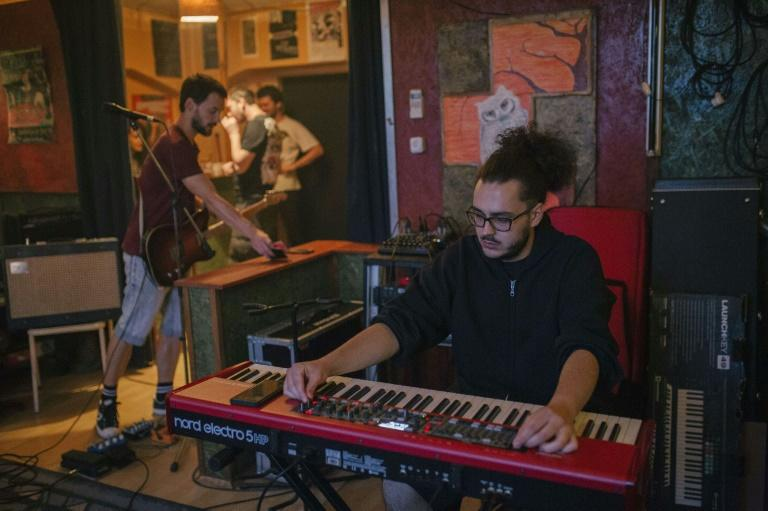 Despite not knowing if they will be able to perform due to the virus, the band rehearses in a former printing and publishing house which has become a mecca for independent musicians and artists in Belgrade