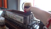 Czech bar uses miniature train to deliver beers to your table