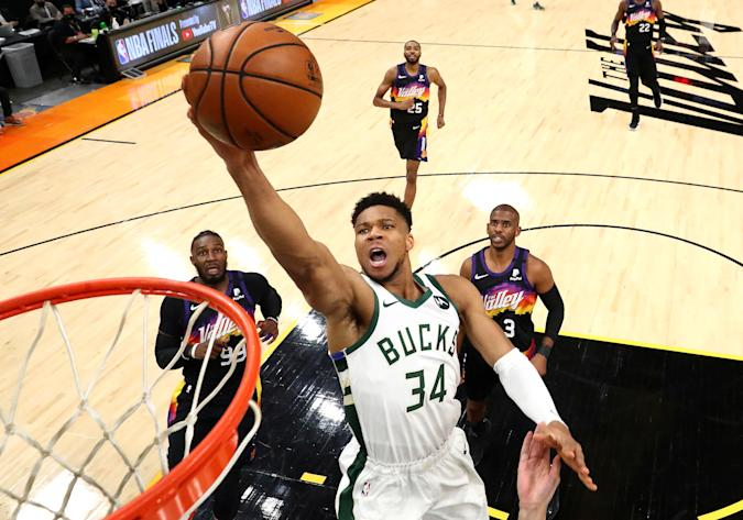 Jul 8, 2021; Phoenix, Arizona, USA; Milwaukee Bucks forward Giannis Antetokounmpo (34) moves in for a basket ahead of Phoenix Suns forward Jae Crowder (99) and guard Chris Paul (3) during game two of the 2021 NBA Finals at Phoenix Suns Arena. Mandatory Credit: Mark J. Rebilas-USA TODAY Sports     TPX IMAGES OF THE DAY