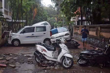 Damaged vehicles are seen following heavy rains in Pune