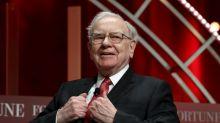 Buffett's Berkshire tops profit forecasts despite trade drag, record cash
