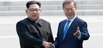 Korean summit starts with historic handshake