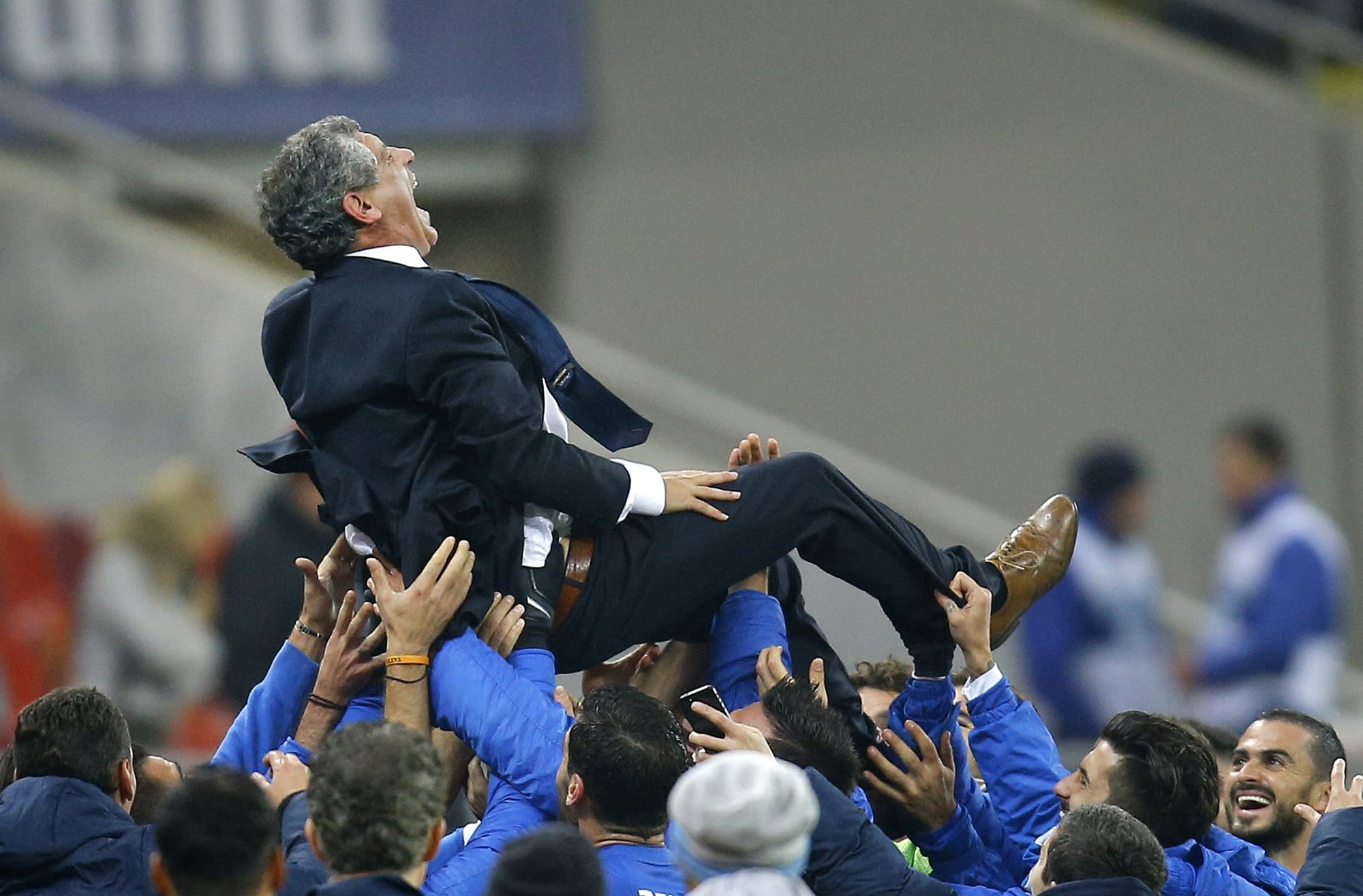 FILE - Fernando Santos, the coach of Greece is thrown into the air by his team at the end of the World Cup qualifying playoff second leg soccer match against Romania at the National Arena in Bucharest, Tuesday, Nov. 19, 2013. Greece drew the match 1-1 and qualified for Brazil 2014 4-2 on aggregate. Greece's Football Association said Thursday Feb. 27, 2014, that national coach Fernando Santos will step down following the World Cup in Brazil, after a successful four-year term on the job that saw the country rise to 12th place in the the FIFA world rankings. (AP Photo/Vadim Ghirda, File)