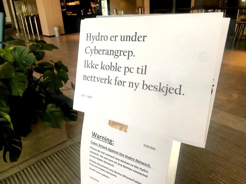 FILE PHOTO: A sign warning employees not to connect devices to the network in the wake of a cyber attack is seen at the headquarters of aluminum producer Norsk Hydro in Oslo