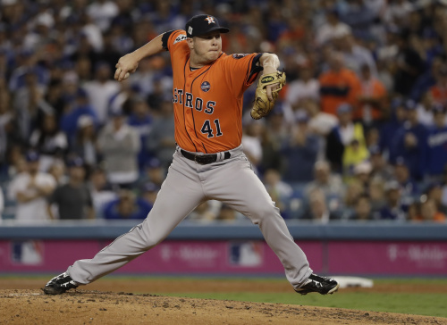 Brad Peacock throws during the third inning of Game 7 of the World Series. (AP)