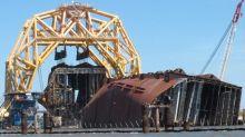 Days of cleanup after shipwreck oil leak fouls Georgia beach