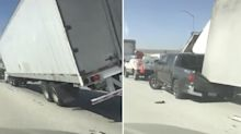 Amazing video shows truck blown over by strong winds, crushing ute