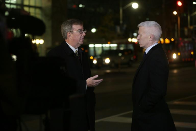 Ottawa Mayor Jim Watson (left) speaks to CNN journalist Anderson Cooper in October 2014