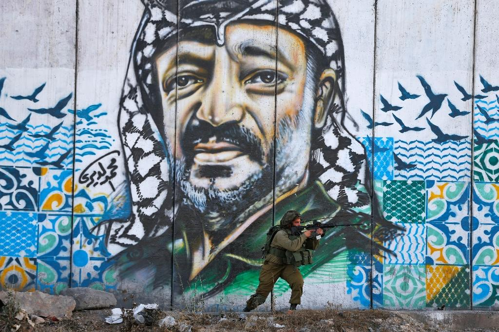 For many young Palestinians, the landmark Oslo accord, which Yasser Arafat signed with Israeli prime minister Yitzhak Rabin 25 years ago on Thursday, was a betrayal that has only consolidated Israel's occupation (AFP Photo/ABBAS MOMANI)