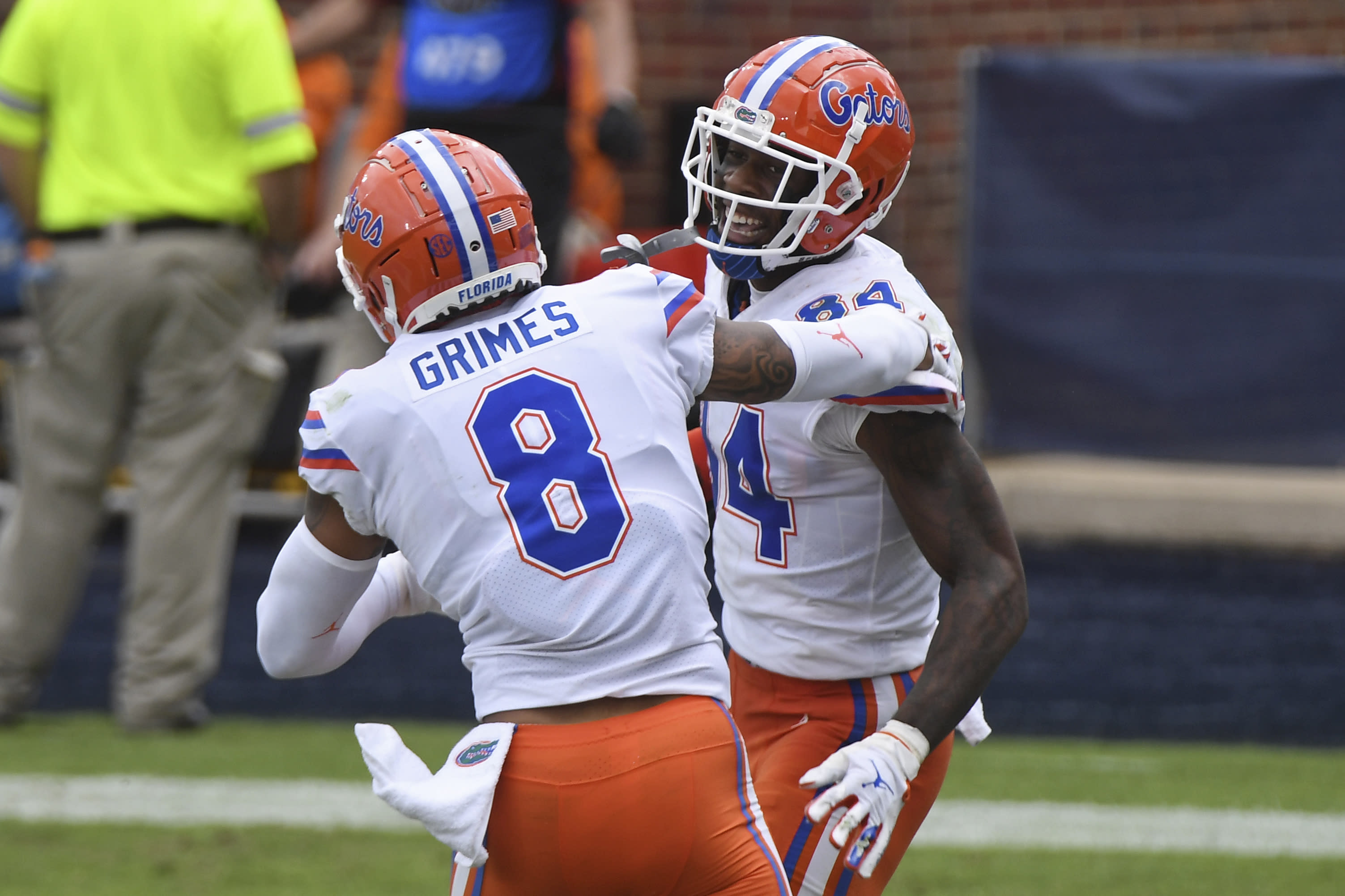 Florida tight end Kyle Pitts (84) and wide receiver Trevon Grimes (8) celebrate after a touchdown by Pitts during the second half of an NCAA college football game against Mississippi in Oxford, Miss., Saturday, Sept. 26, 2020. No. 5 Florida won 51-35. (AP Photo/Thomas Graning)