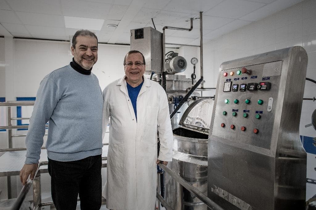 Samir Constantini (L), CEO and founder of Aleppo soap company Alepia, poses for a photo with soap maker Hassan Harastani, in Santeny, 30 km from Paris (AFP Photo/Philippe Lopez)