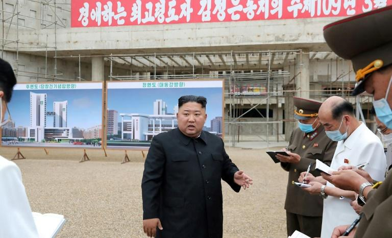Kim sacks officials for extortion linked to project