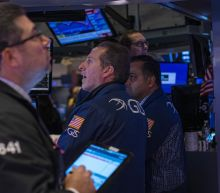 Stock market news live: Stocks end week lower as confirmed cases of coronavirus rise