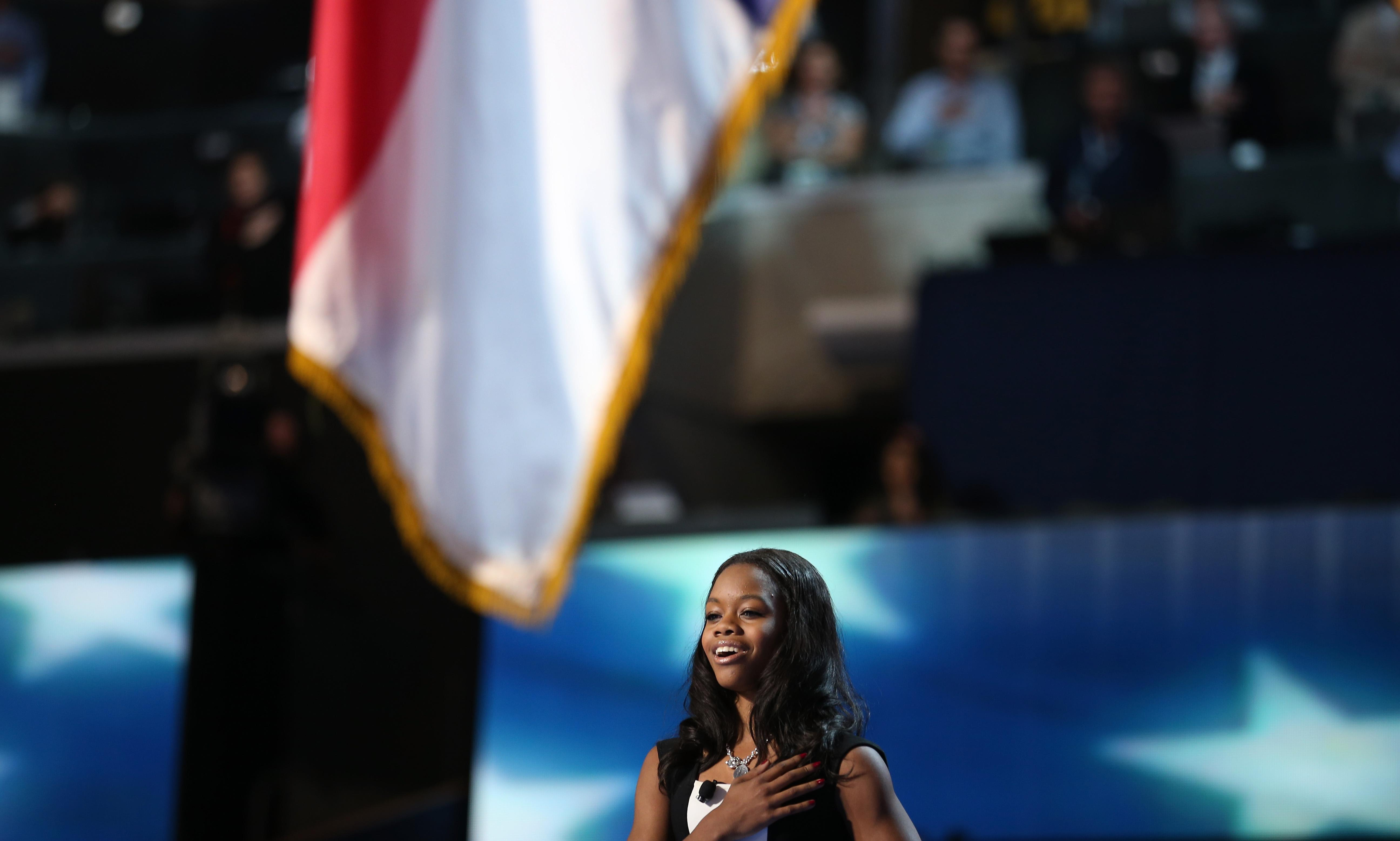 CHARLOTTE, NC - SEPTEMBER 05: Olympic gymnast Gabby Douglas leads the Pledge of Allegiance during day two of the Democratic National Convention at Time Warner Cable Arena on September 5, 2012 in Charlotte, North Carolina. The DNC that will run through September 7, will nominate U.S. President Barack Obama as the Democratic presidential candidate. (Photo by Chip Somodevilla/Getty Images)
