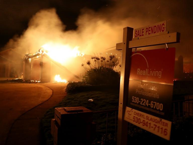 California wildfire: Two children among five dead and 17 missing as disaster intensifies