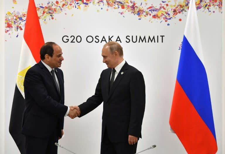 Russian President Vladimir Putin (R) has fostered Egyptian President Abdel Fattah al-Sisi (L) as an ally (AFP Photo/Yuri KADOBNOV)
