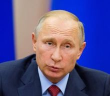 Putin dials up anti-U.S. rhetoric, keeps mum on re-election