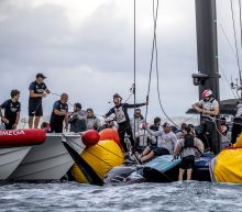 US team vows to continue after America's Cup capsize