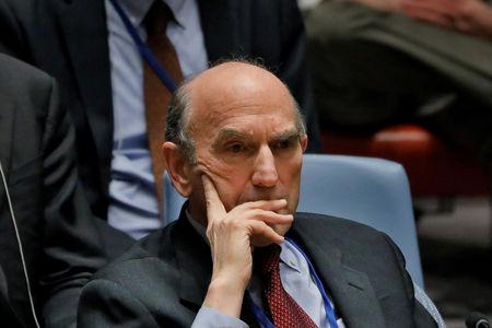 FILE PHOTO: United States diplomat Elliott Abrams listens during a meeting of the U.N. Security Council called to vote on a U.S. draft resolution calling for free and fair presidential elections in Venezuela at U.N. headquarters in New York, U.S., February 28, 2019. REUTERS/Lucas Jackson/File Photo