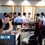 Hong Kong Police Raid Apple Daily News Offices, Citing National Security Law