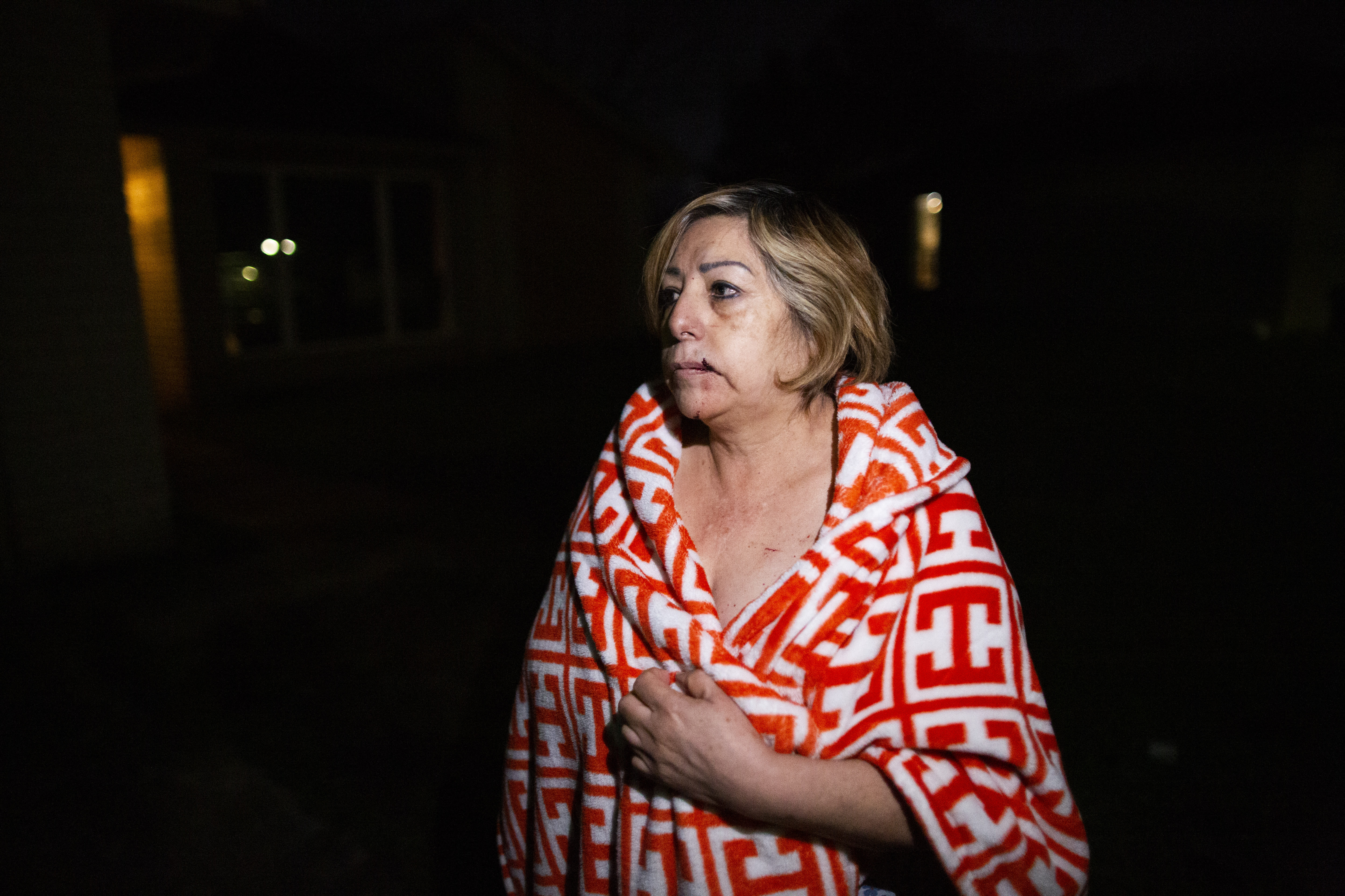 Maria Olivo, a west Houston resident, is shown after a massive explosion blew the window in the room she was sleeping in on Friday, Jan. 24, 2020, in Houston. A massive explosion early Friday leveled a warehouse in Houston and damaged nearby buildings and homes, rousing frightened people from their sleep miles away. (Marie D. De Jesús/Houston Chronicle via AP)