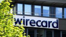 German lawmakers criticise Scholz and Merkel over Wirecard - draft report