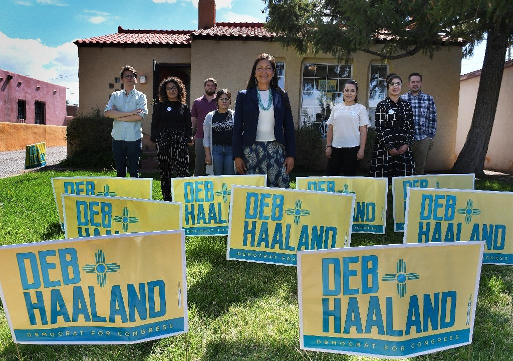 Deb Haaland -- shown surrounded by campaign staff at her office in Albuqurque, New Mexico -- is vying to be the first native American woman elected to Congress (AFP Photo/Mark RALSTON)