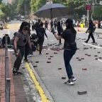 Protesters Outside Hong Kong Polytechnic University Lay Brick Roadblocks
