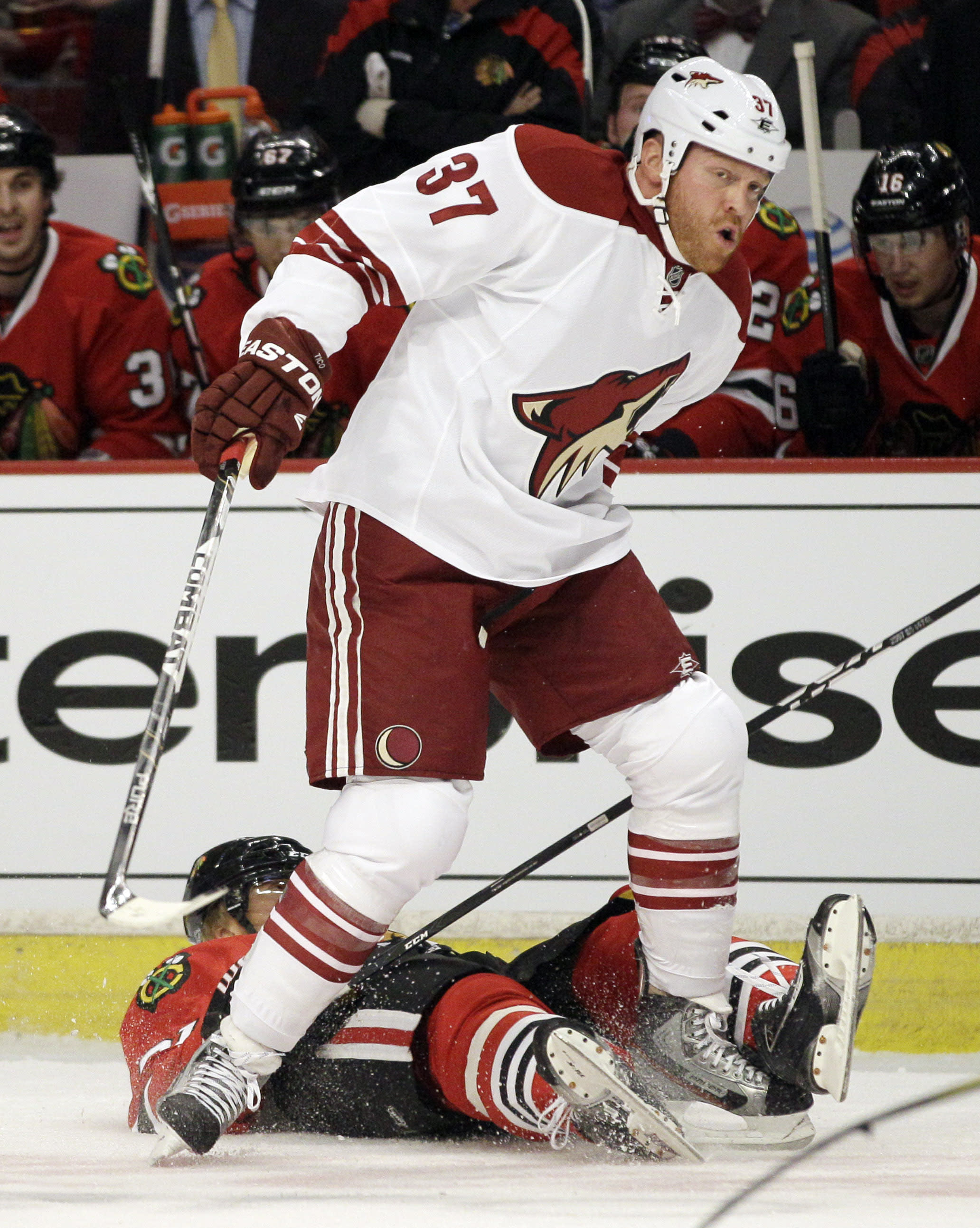 CORRECTS HOSSA FROM SLOVAKIA, NOT RUSSIA - Chicago Blackhawks' Marian Hossa (81) of Slovakia, falls down after hit from Phoenix Coyotes' Raffi Torres (37) during the first period of Game 3 of an NHL hockey Stanley Cup first-round playoff series in Chicago, Tuesday, April 17, 2012. (AP Photo/Nam Y. Huh)