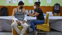 India's vaccine drive: Stories from the best and worst districts