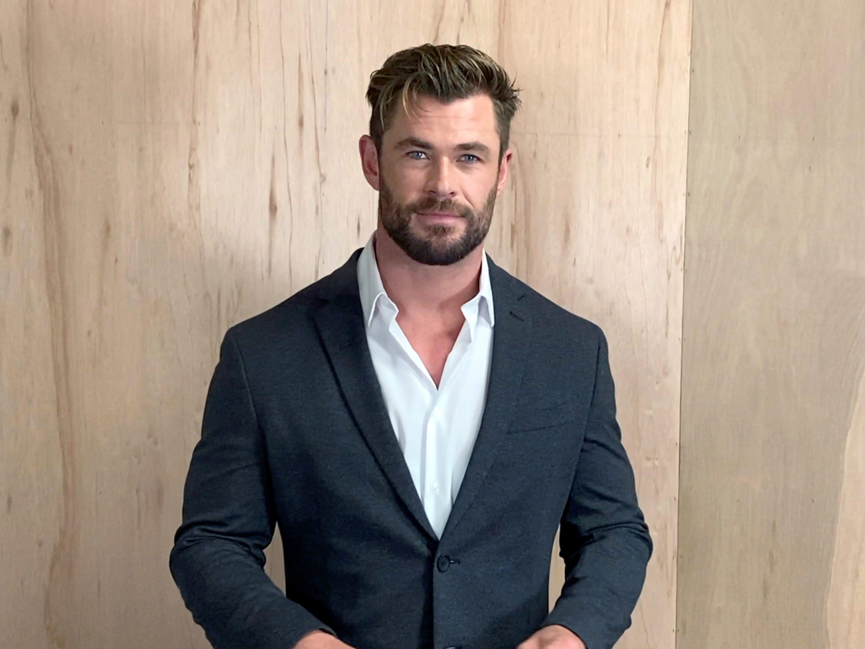 Chris Hemsworth posted a photo of his enormous arms - but people are just  commenting on his skinny legs