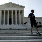 Thomas spoke, Roberts ruled in unusual Supreme Court term