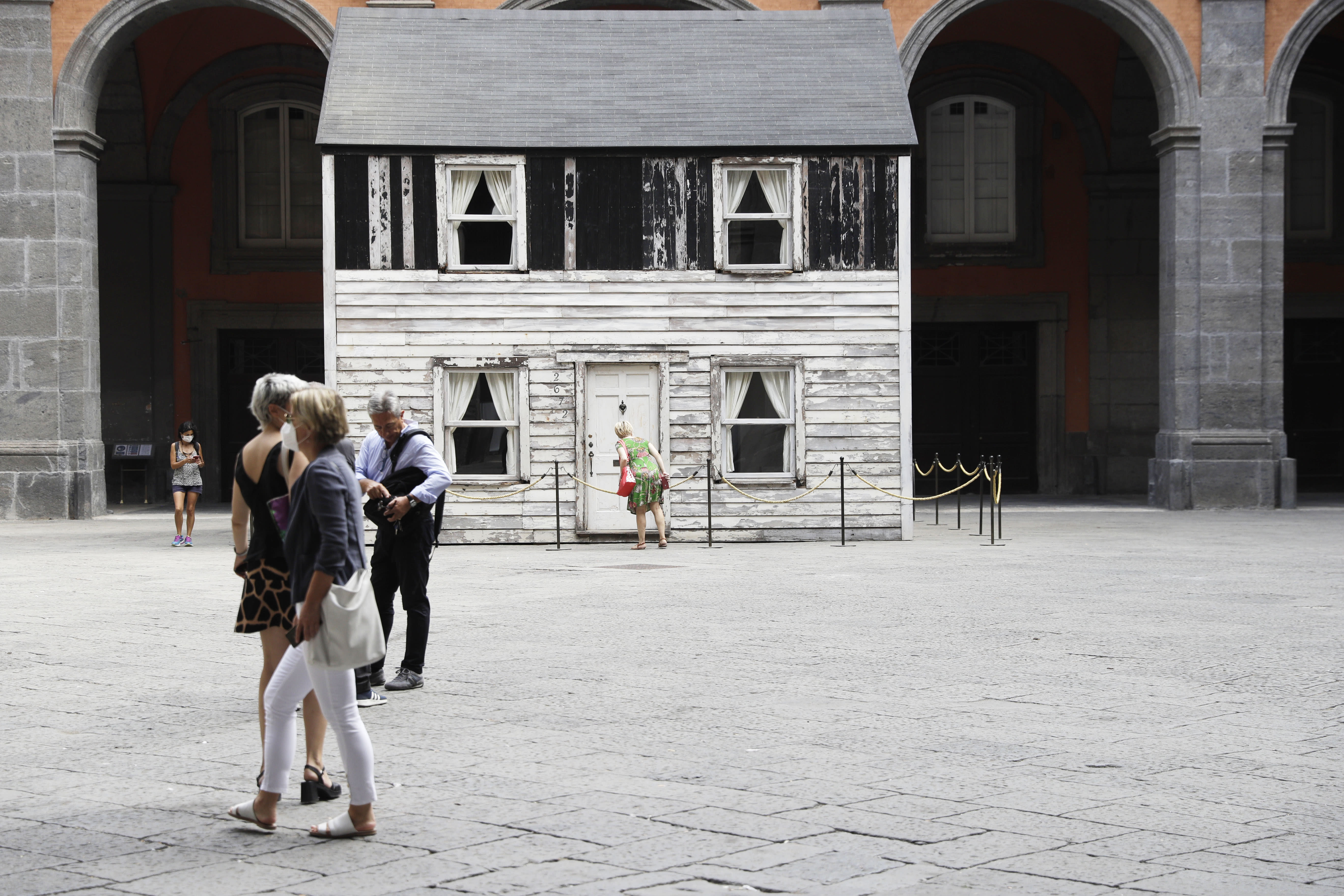 The house of U.S. civil rights campaigner Rosa Parks, rebuilt by artist Ryan Mendoza, is on display in Naples, Italy, Tuesday, Sept. 15, 2020. The rundown, paint-chipped Detroit house where Parks took refuge after her famous bus boycott is going on display in a setting that couldn't be more incongruous: the imposing central courtyard of the 18th century Royal Palace. (AP Photo/Gregorio Borgia)