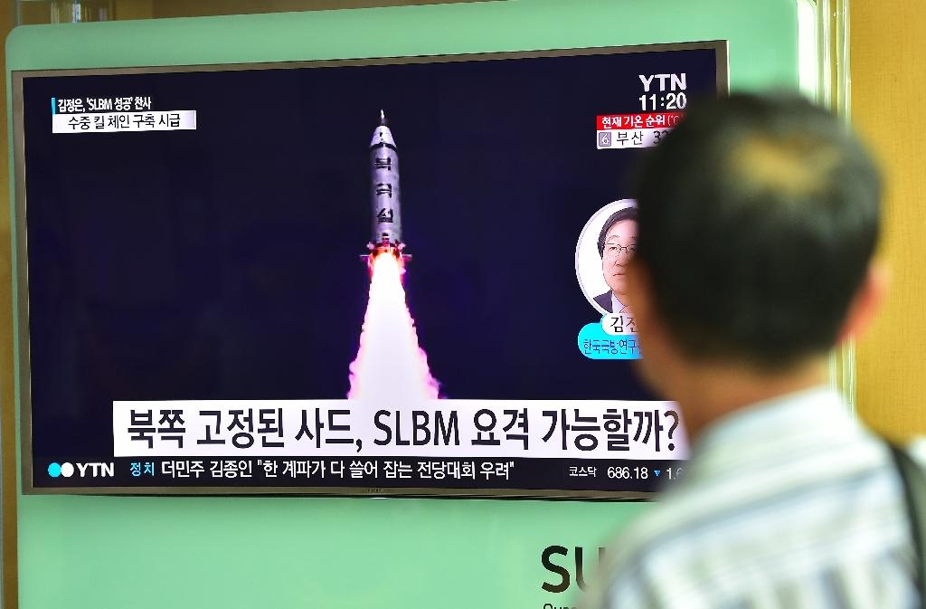 A man at a railway station in Seoul watches a television screen reporting news of North Korea's latest missile test (AFP Photo/JUNG YEON-JE)