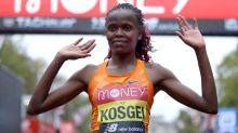 Brigid Kosgei defends her London Marathon title around sodden St James's Park