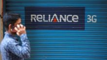 RCom reports smaller loss in first quarter