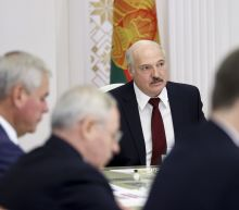 Belarus leader seeks to punish striking workers, students
