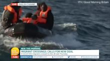 Boat full of migrants spotted in background during ITV broadcast