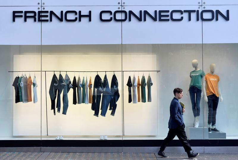 035380e9854 FILE PHOTO - A person walks past a French Connection store in London,  Britain