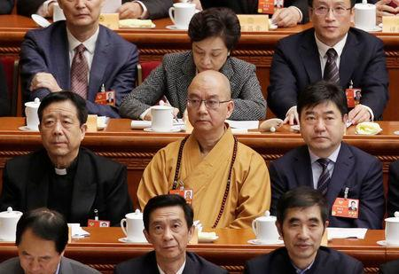 FILE PHOTO: Xuecheng, the delegate of the CPPCC and the abbot of the Longquan Temple, attends the opening session of the CPPCC in Beijing