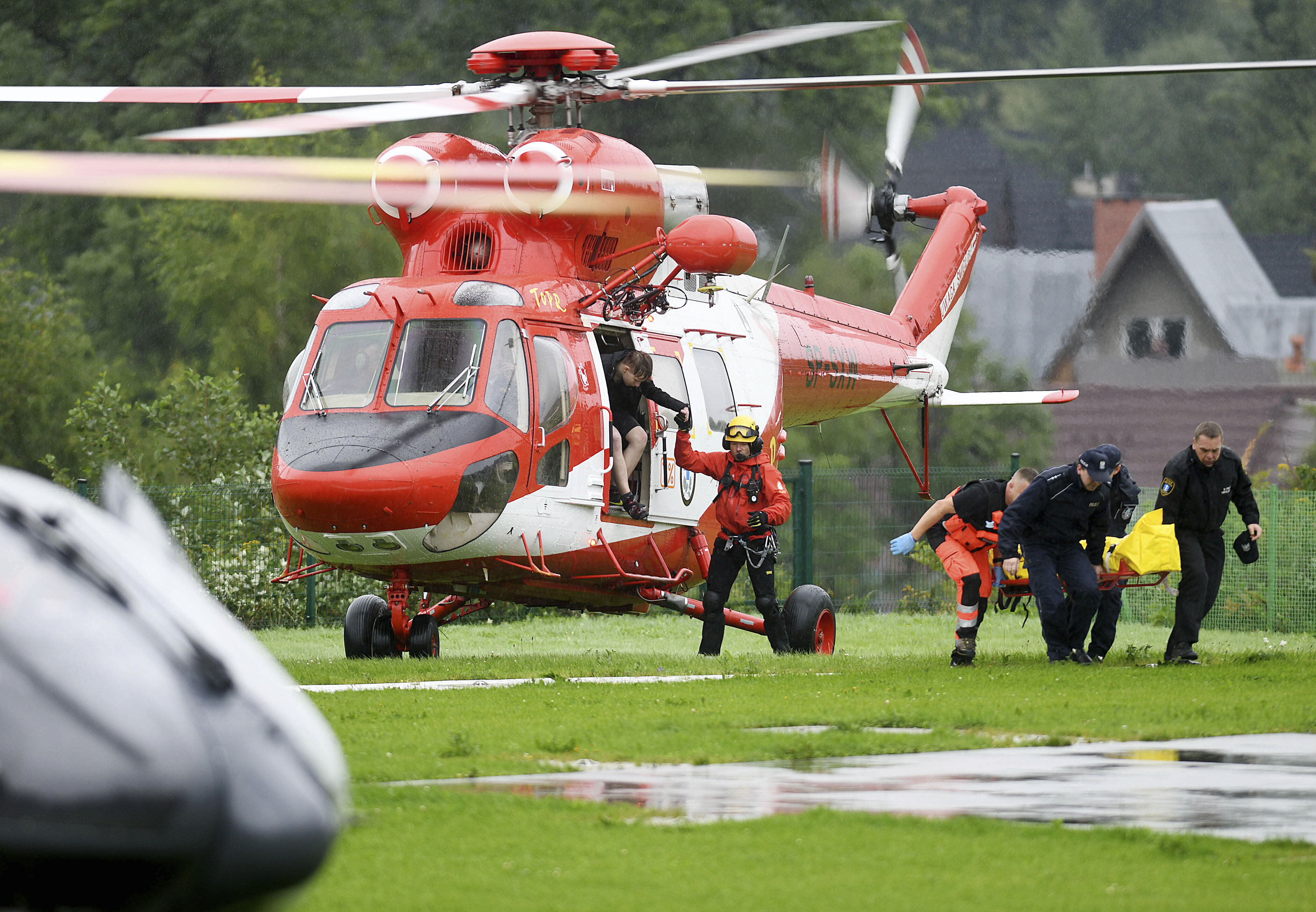 Rescue helicopter have brought to hospital the first people injured by a lighting that struck in Poland's southern Tatra Mountains during a sudden thunderstorm, in Zakopane, Poland, on Thursday, Aug. 22, 2019. (AP Photo/Bartlomiej Jurecki)
